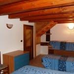 casegranparadiso-appartamento-7t-letti-camera