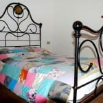 casegranparadiso-bilocale-102b-letto-finestra