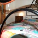 casegranparadiso-bilocale-102b-letto-particolare