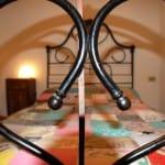casegranparadiso-bilocale-102b-letto-cuore