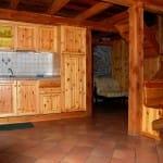 casegranparadiso-appartamento-103b-cucina-poltrona