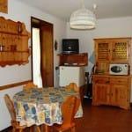 casegranparadiso-appartamento104b-soggiorno-tv-frigo