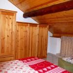 casegranparadiso-appartamento-1b-letto-finestra